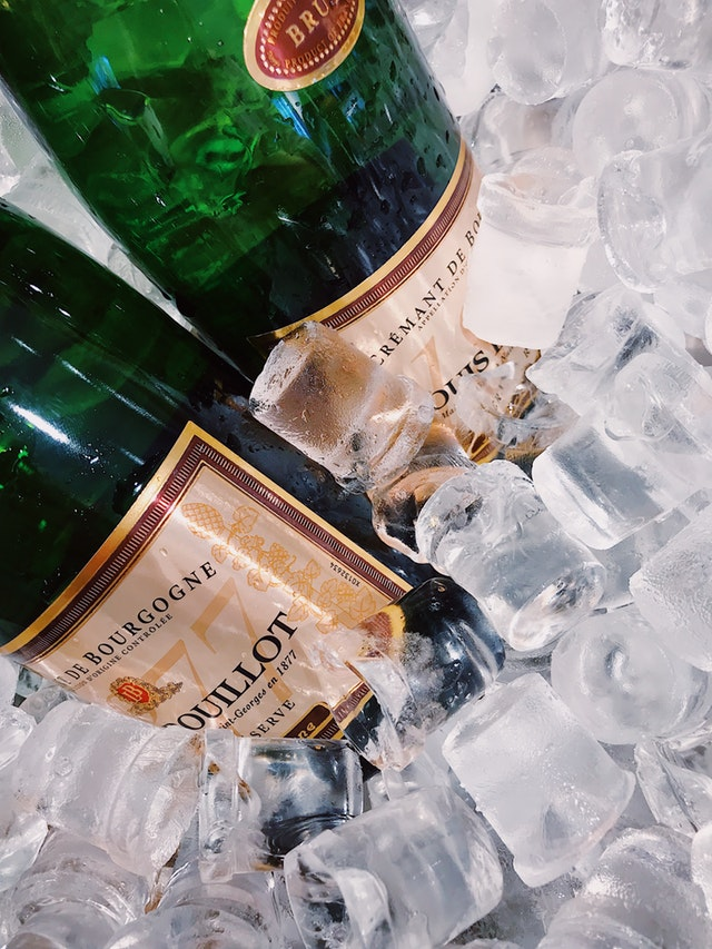 Two Wine Bottles on Ice